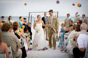 Beach balls can be a fun way for guests to celebrate the couple. Photo Credit: Meg Baisden Photography
