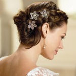 Whether you choose this beautiful updo or wear your hair down, there are tips you can follow to help make your wedding day a great hair day! You can read more tips at bridalguide.com.