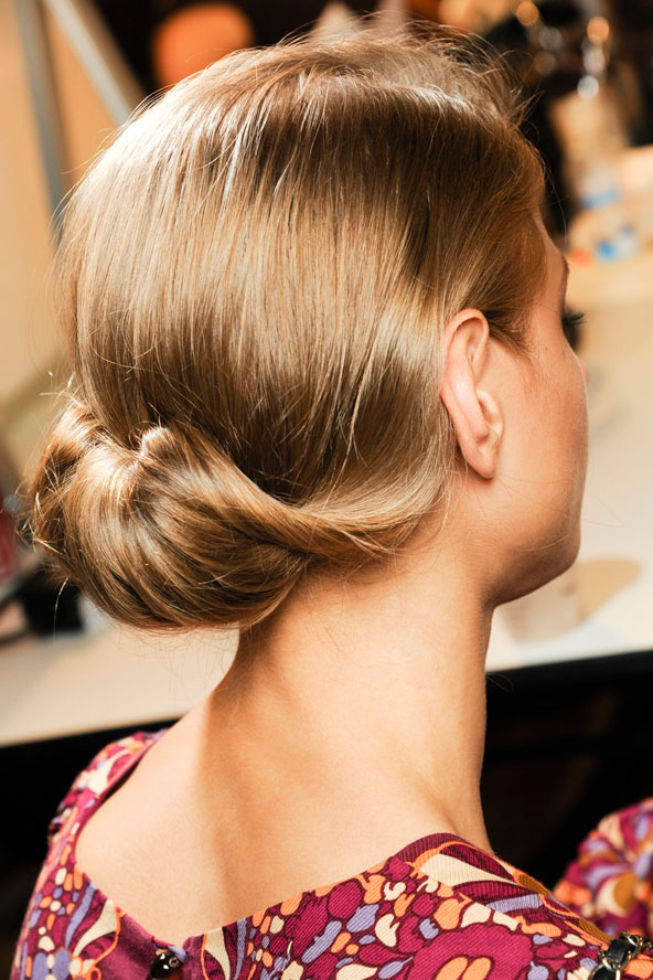 This twisted, low up-do will work on any hair colour, at any age. Taken from the Dior show, the style is side-parted at the front with a little root lift.