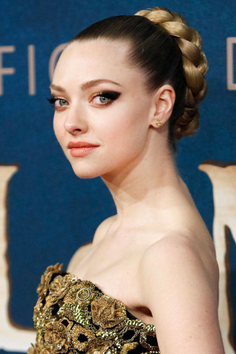 If you have an ornate gown, this look worn by Amanda Seyfried is a great match. This flawless braided bun coils around to epic proportions thanks to a few extensions, says Elle Magazine. (Getty Images)