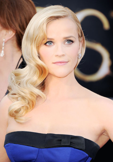 Reese Witherspoon looks amazing in almost any style. This soft, wavy style is perfect for a wedding. If you want something subtle, understated but classic and elegant, this look might be for you. You, too, can channel an old-Hollywood movie star, as Elle magazine describes this look. (Getty Images)