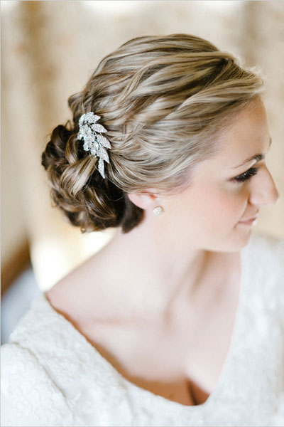 The twisted strands and leaf hair-clip add texture to this understated bun. Photo by: Erich McVey on Wedding Chicks via Lover.ly
